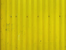 Metal bright yellow dirty old background texture with screws. Stock Photography