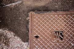 Rusty manhole cover Royalty Free Stock Photography
