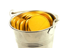 Metal bucket with gold coins Royalty Free Stock Photography