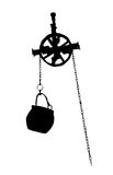 Metal bucket hanging on the pulley, black and white vector graph Stock Image