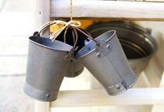 Metal bucket. Mini metal bucket on market royalty free stock images