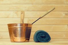 Metal bucket and towel. Royalty Free Stock Photo