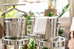 Metal buckets with an ice for cooling drinks. Service area the waiter in restaurant. silver shiny container. Catering. Set-up ready for the event to begin royalty free stock photography