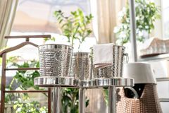Metal buckets with an ice for cooling drinks. Service area the waiter in restaurant. silver shiny container. Catering stock image