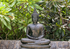 Metal buddha statue lotus pose . Stock Photos