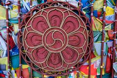 Metal Buddhist lostus symbol on temple wall. Close up beautiful metal lotus flower, buddhist symbol on wall of temple royalty free stock image