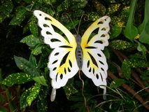 Metal Butterfly. Rusted metal butterfly between plants Stock Photography
