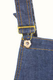 Metal button of dungarees close up on white wall Royalty Free Stock Photos