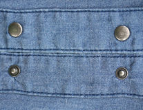 Metal buttons on jeans background Stock Photography