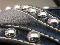 Metal buttons and leather Stock Photo