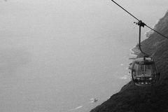 Metal Cable Car Going Up Grayscale Photo Stock Image