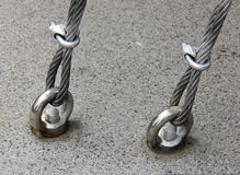 Metal cables attached on floor Royalty Free Stock Photography