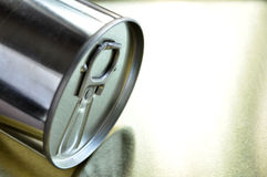 Metal can on shiny surface. A silvery metal can rest on shiny surface Stock Photography