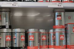 Metal canisters of illy coffee beans royalty free stock photos