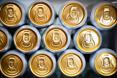 Metal cans with refreshing drinks. Macro of metal cans with refreshing drinks royalty free stock photography