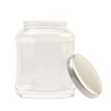 Metal cap next to a glass jar Stock Photography