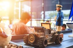 A Metal car toy on the table in the coffee shop. A Metal car toy in the coffee shop royalty free stock photo