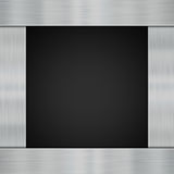 Metal on carbon fibre Stock Image