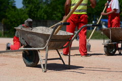 Metal cart with shovel on construction site Stock Photo