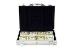 Metal case and lots of dollars Royalty Free Stock Photos