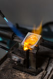 Metal Casting with blowtorch. Close-up of Silver Casting from Crucible to Metal Mold with blowtorch; Goldsmith Workshop Stock Photo