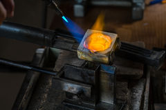 Metal Casting with blowtorch. Metal Casting from Crucible to Metal Mold with blowtorch; Goldsmith Workshop; Close-up Royalty Free Stock Images