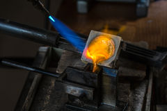 Metal Casting with blowtorch. Metal Casting from Crucible to Metal Mold with blowtorch; Goldsmith Workshop; Close-up Royalty Free Stock Photo