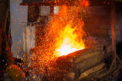 Metal casting in the forge Royalty Free Stock Photos