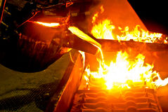 Metal casting process. With high temperature fire in metal part factory stock images