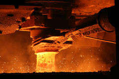 Metal casting process. With high temperature fire in metal parts factory Stock Images