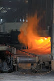 Metal casting process with high temperature fire. In metal part factory Stock Photos