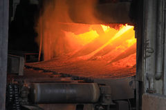 Metal casting process with high temperature fire. In metal part factory Stock Image