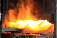 Metal casting process with high temperature fire. In metal part factory Royalty Free Stock Photos