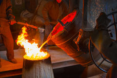 Metal casting in the workshop Royalty Free Stock Image
