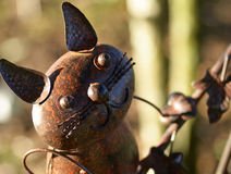 Metal cat garden sculpture. A handcrafted metal cat garden sculpture made with nuts and bolts and screws and loose bits of metal galvanised and soldered together royalty free stock image