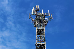 Metal cell antenna tower site against blue sky Royalty Free Stock Images