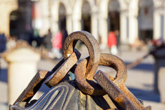Metal chain with big ring. Close up texture of rocky surface with iron chain and ring on it.  Stock Photos