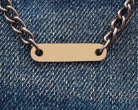 Metal chain on denim Royalty Free Stock Photography