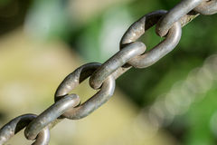 Metal chain diagonally against blurred  background Royalty Free Stock Images