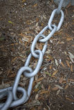 A metal chain on the ground Royalty Free Stock Image