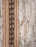 Metal chain and hardware ribbon on the old wood Stock Image
