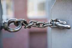 Metal chain links two rings, copy space in the blurry background Royalty Free Stock Photos