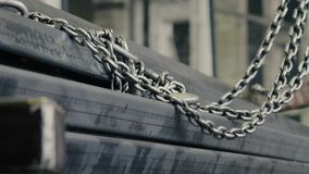 Metal chain of the loader. Close up of metal chain of the loader stock footage