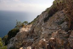A metal chain for moving along a mountain path over the sea. A metal chain for moving along a mountain path over the sea royalty free stock photo