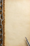 Metal chain and old paper Stock Photography