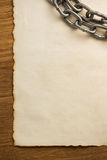Metal chain and old paper Stock Image