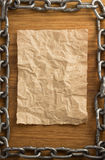 Metal chain and old paper Royalty Free Stock Photography