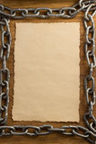 Metal chain and old paper Stock Photos