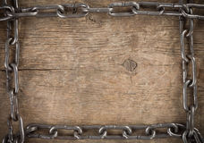 Metal chain on old wood Royalty Free Stock Photography