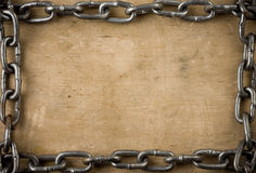 Metal chain on old wood texture Royalty Free Stock Photo